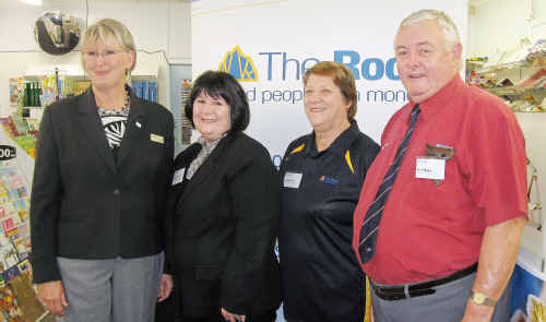 North Burnett Mayor Joy Jensen opens the new branch with retail banking executive Leigh Zimmerlie and owners Carol Williams and Ian Williams.