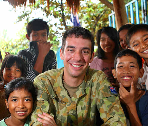 REWARDING WORK: Cameron drew on his experience working on a cattle station to cope with humanitarian missions in Vietnam and Cambodia. cont