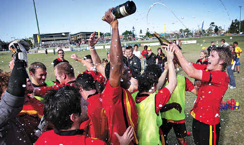 Great day for the club: The Sunshine Coast Fire celebrates its 2008 grand final win over the Brisbane Strikers.