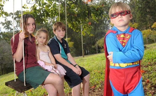 ON A MISSION: Benaton Moore, 5, aka Superman, and his siblings, Cartia, 12, Summer, 4, and Jsjiah, 10.