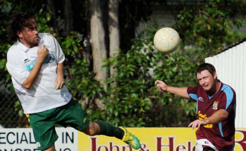 Brothers Aston Villa's Josh McGuiness crosses the ball.