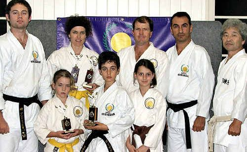 Members of the JKS Karate Club that performed well at a recent tournament with instructors.