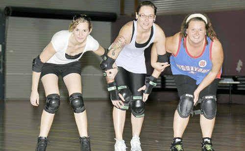 GIRLS GEAR UP: Roller Derby participants, from left, Rhiannon Galloway (derby name: Rhi-load), Amanda Keogh (aka Ms Kamakazi) and Linda Fahle (derby name: Traumatron).