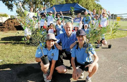Justin Kuhnel, Toyota representative Scott Churchill and Jacob Reid at the Bundaberg State High School tree planting day.