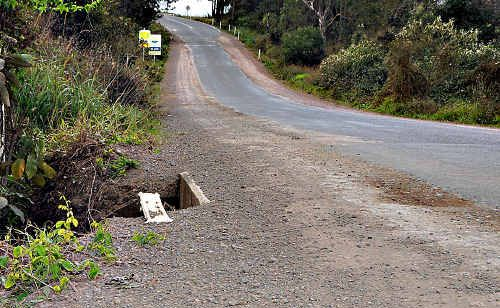 With the likelihood of growing traffic volumes, a flattened guidepost presents new dangers to Moy Pocket Road drivers and illustrates the danger there already.