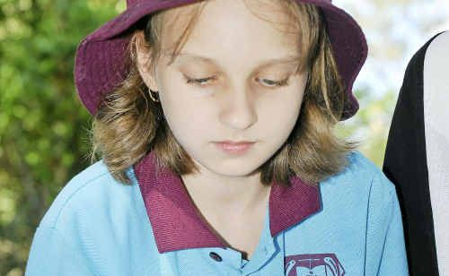 IN THE GARDEN: Kinberly Anderson, 10, learns about the environment.