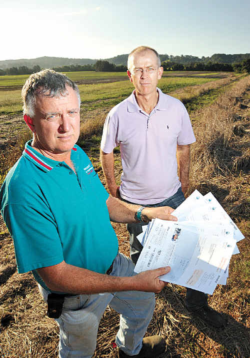 Farmers Ross Boyle, left, and Mark Garrett were shocked to learn that the primary producers exemption for unconnected water charges that they have always received for their properties has now been ignored by Unity Water. Ross owns Rosemount Turf on Petrie Creek Road and Mark has properties on Bli Bli Road.