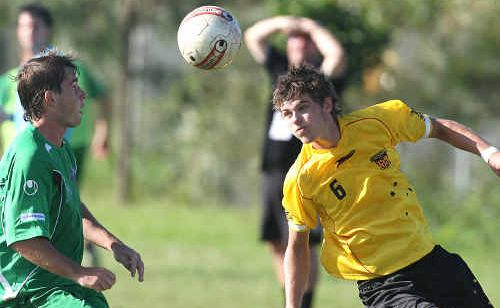 Midfielder Corey Towle, right, returns to the Fire's line-up tomorrow after serving a one-match ban.