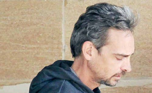 Anthony Merrick in custody at the Warwick watch house yesterday.