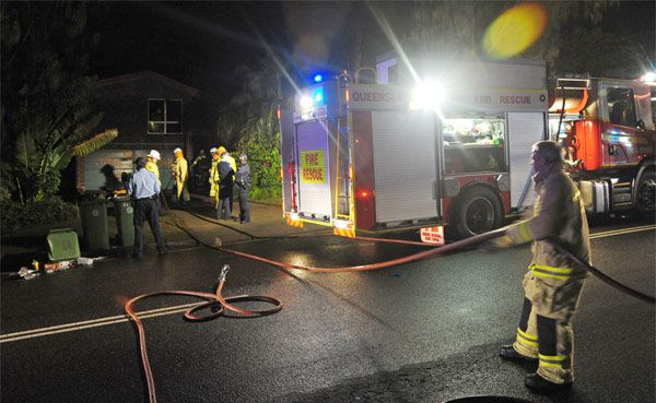 Fire crews at the scene of a house fire in Shelly Beach, which damaged two upstairs bedrooms. Police are investigating.
