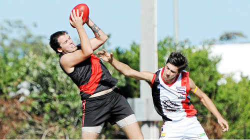 Mathew Innes, takes a nice mark in the Brothers seniors v Bombers' game.
