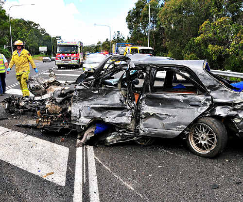 The aftermath of a head-on crash near Pioneer Road on the Bruce Highway at Pomona.