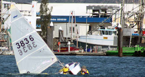 New sailors learn to right an upturned dinghy.