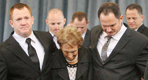 Sandra Walters is flanked by her sons at yesterday's funeral for Kevin Walters Senior.