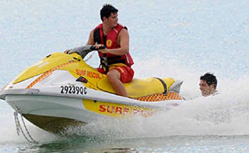 Rainbow Beach lifeguard Lleam Rees practices his skills on Jetski at Rainbow Beach.