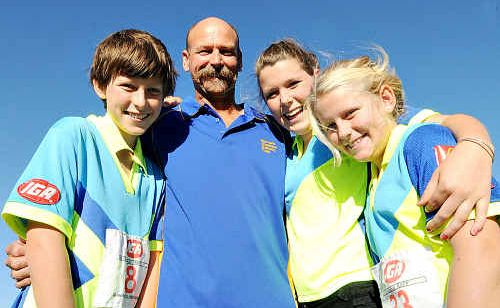 Zack, Hannah and Sophie Roff, with their father David, enjoy the challenge of athletics and will sign up for the Gympie Amateur Athletics Club's new season this Saturday at Albert Park. The club places an emphasis on family participation and having fun. This year, the club hopes to attract more new members and continue the success of the previous season.