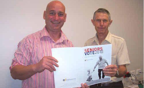 Gladstone Branch National Seniors Association president Roy Jones discussing the Seniors Vote 2010 with Member for Flynn Chris Trevor.