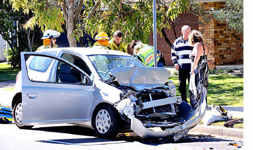 The elderly driver of this car was badly hurt after it crashed into a parked RACQ vehicle in Warana yesterday.