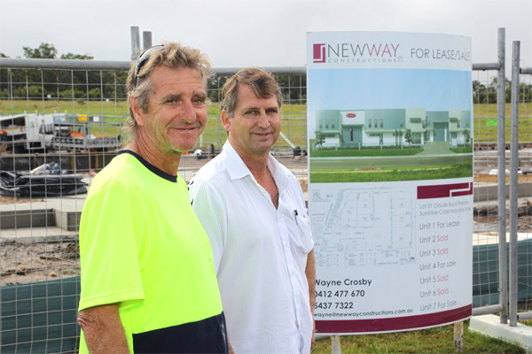 EAR TO THE GROUND: Wayne Crosby, right, with site foreman Will Ackroyd at the Industrial Park in Caloundra which has was able to strata.