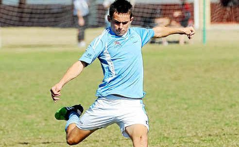 Bundaberg Spirit Youth player Michael Coleman moves the ball downfield against Queensland Academy of Sport Youth at Martens Oval.
