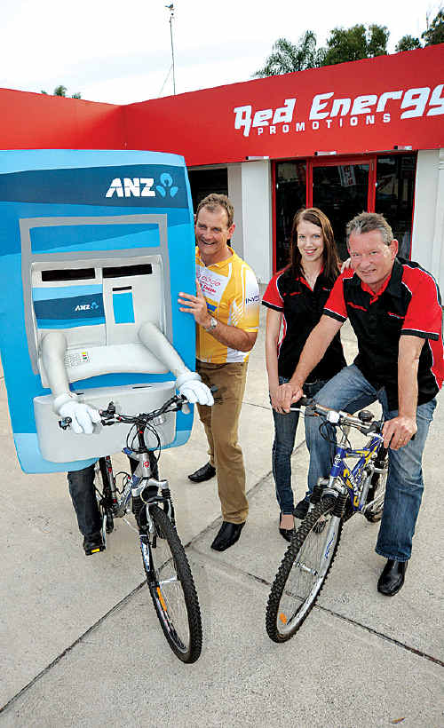 ANZ district executive Darrell Edwards with his ATM mascot, and Red Energy's Tamika Fowler and John Leach.