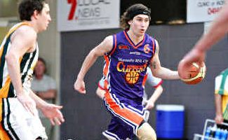 In control: Scott Kenny runs the ball up the court for the Clippers against the Ipswich Force at Maroochydore yesterday.