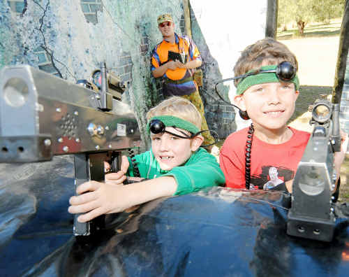 Blake Harris and Thomas Woodland play Laser Skirmish at the Family Fun Day held at Moore Park Beach Tavern to help raise funds for the Deakin family.