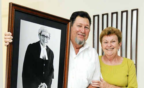 Proud parents Alan and Maree Baumgartner with a portrait of their son Tony Baumgartner.
