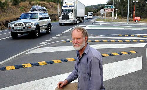 Greg Edwards says changes, like these speed bumps, have made the Wide Bay Highway/Bruce Highway intersection more dangerous than ever.
