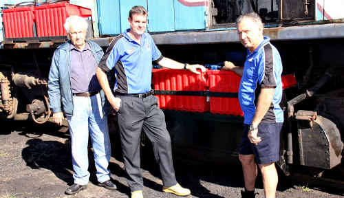 Mary Valley Heritage Rail volunteers Nev Caldwell (left) and Fred Kruik (right) with sponsor Russell Brown of Positive Batteries.