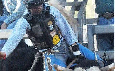 Kyogle's Dave Kennedy hangs on to Lethal Injection at the Mt Isa rodeo at the weekend.