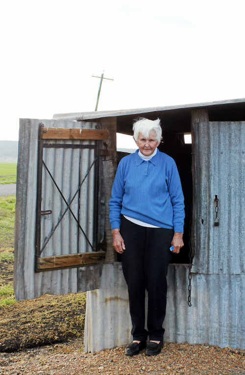 Barbara Norvill beside her bore that's been dry for five years.
