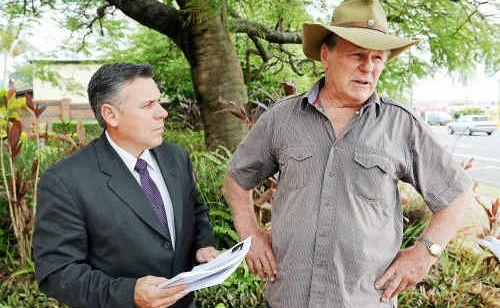 Member for Burnett Rob Messenger and former patient George Pauza outside the Bundaberg Police Station.
