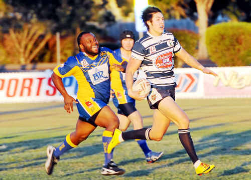 Across The Waves' Abraham Broome gives chase in a blistering run by Brothers fullback Tien Nguyen at Salter Oval.