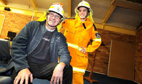 Kadina High Year 10 student Jason Balderi, of Goonellabah, a graduate of the Rural Fire Service Schools Cadet Program, with his father Robert who, thanks to his son, is also inspired to join the service.