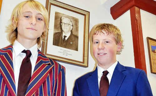 Warwick State High School student Nic Grayson (left) wears his grandfather's 1924 Past Students' Association blazer with his second cousin Lane Grayson in the modern-day equivalent.