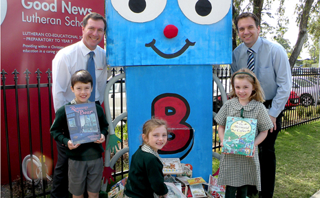 Principal Adam Richardson and Councillor Matthew Bourke with students and Billy the Bookworm.