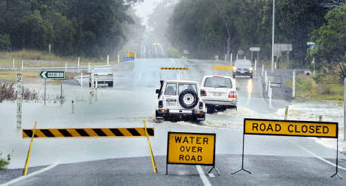 Booral Road near Main Street was closed yesterday and police were warning motorists not to drive through as wet weather pounded the Fraser Coast.