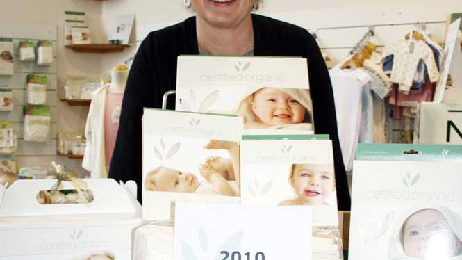 Nature's Child owner Jannine Barron proudly shows off her organic cotton baby product range which has won a gold medal at the Organic Expo Industry awards.
