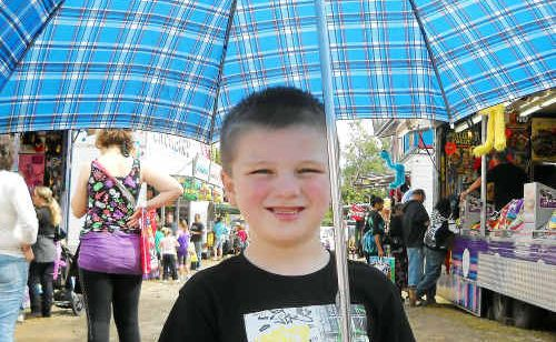 The rain didn't stop Cobey Norberton, 5, from going to the Gladstone show.