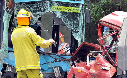 Emergency personnel attend last year's fatal Sunbus accident in which Bruce Kent was killed.