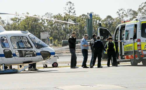 Australian Helicopters deliver survivors at including Rod, Chris and Jake Riley.
