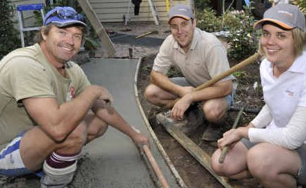 Volunteer workers, from left, Paul Galvin, Brendan Mattiazzi and Peta Munro workon a new pathway at Bloomhill Cancer Centre.