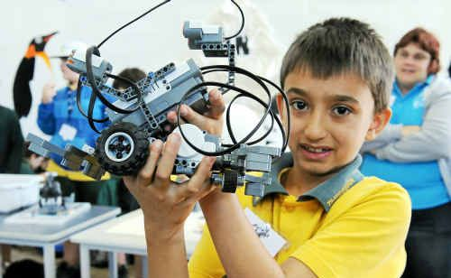 Thabeban student Joshua Whalley with his robot named Evil Elmo at the Central Queensland University primary school robotics competition.