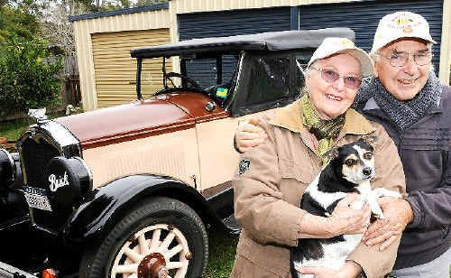 Noel and Nancy Gill, of Alstonville, with their dog Beth, proudly show off their restored 1927 Buick tourer.
