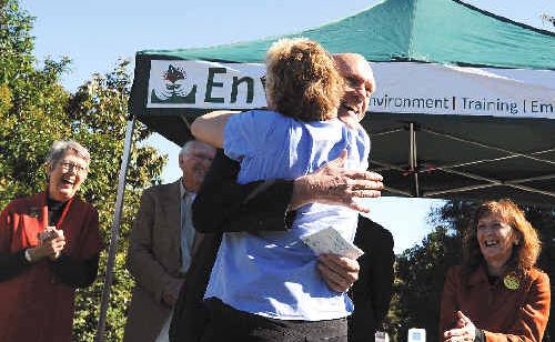 WetlandCare Australia general manager Nicci Carter embraces Environment Minister Peter Garrett yesterday after he pledged $2.5 million to protect coastal wetlands.