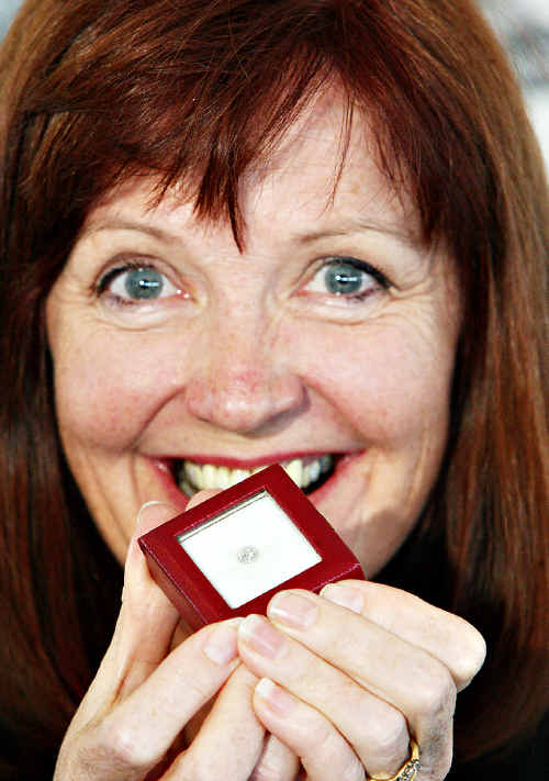 Anne-Maree Grant displays the $10,000 diamond she scored at the charity lunch.