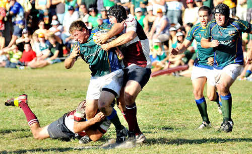 """University's Brett Longfield, being tackled, says the Barbarians are not """"too far away from where we need to be""""."""