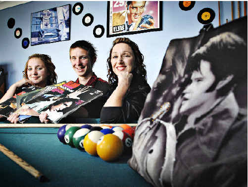 Elvis Presley devotee Bronwyn Grill at home in Coraki with her children Rebecca, 16, and Adam, 18, and surrounded by some of Mrs Grill's Elvis memorabilia in a room entirely dedicated to the memory of the late King of Rock.