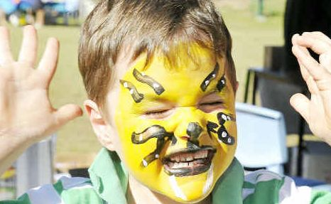 William Lyons, 5 from Victoria enjoying the face-painting at the Market Day at St Francis Catholic School, Tannum Sands.